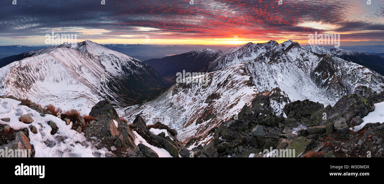 Majestic sunset in winter mountains landscape - Stock Image