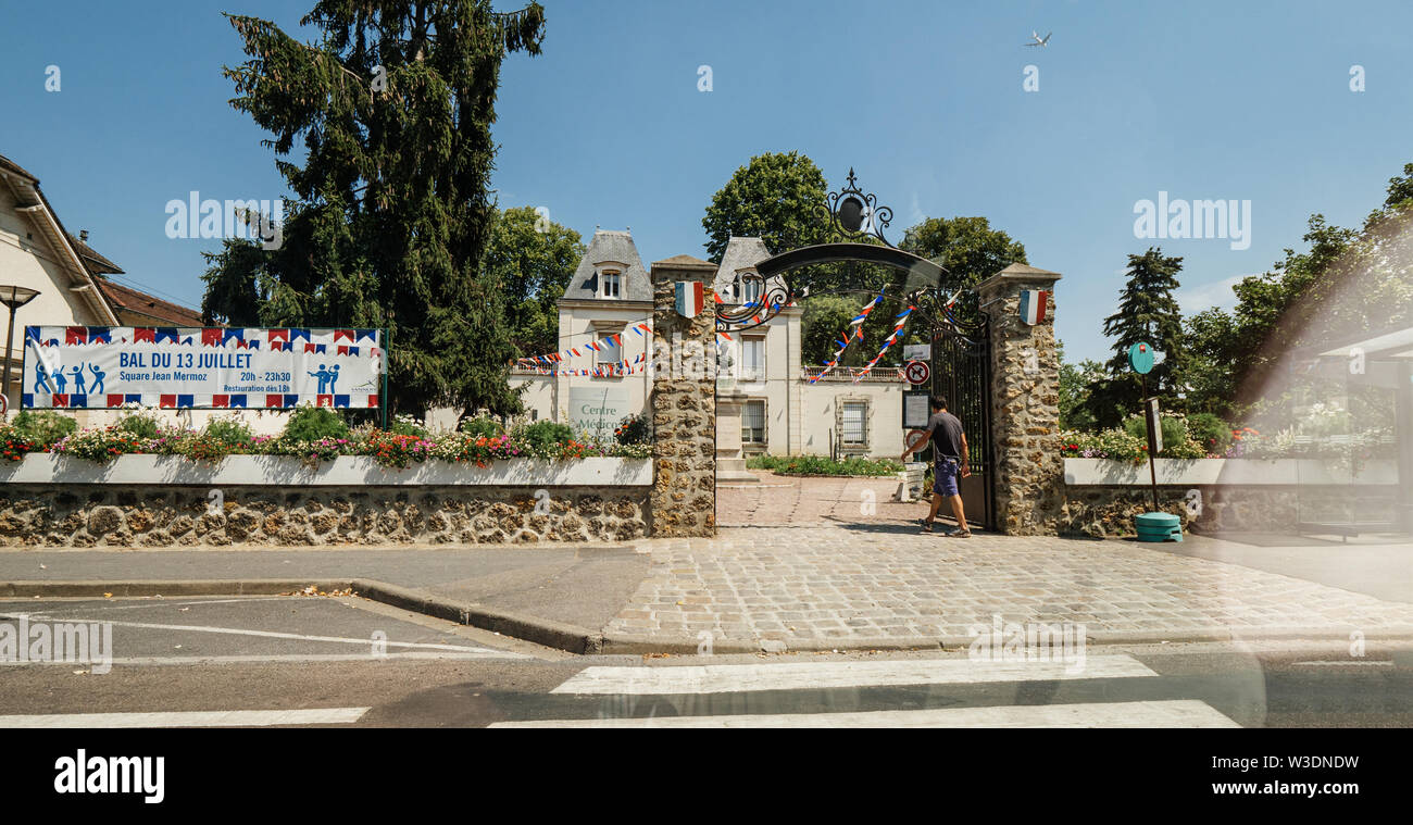 Paris, France - Jul 15, 2018: French building of Centre Medico Social with advertising to Bal du 13 Juillet - Stock Image
