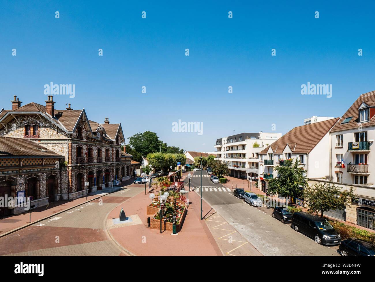 Saint-Gratien, France - Jul 15, 2018: Aerial drone view of Saint Gratien with central Train Station. Saint-Gratien is a commune in the northern suburbs of Paris - Stock Image