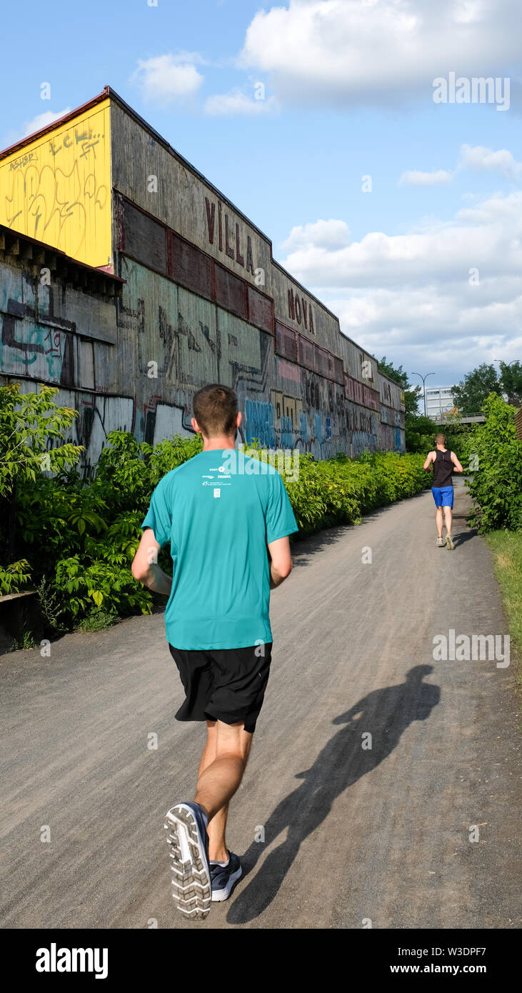 Jogger at Réseau-Vert, a popular multi-functional trail, Montreal - Stock Image