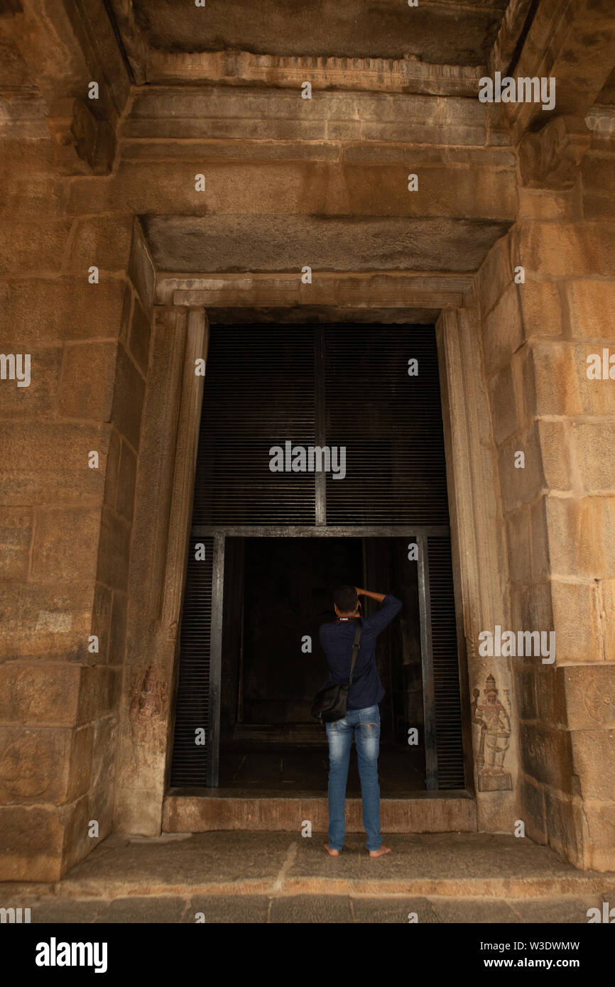 Hampi, India July 8, 2019 : Photographer taking the picture of Holy Kadale Kalu ganesha temple in Hampi, Karnataka, India - Stock Image
