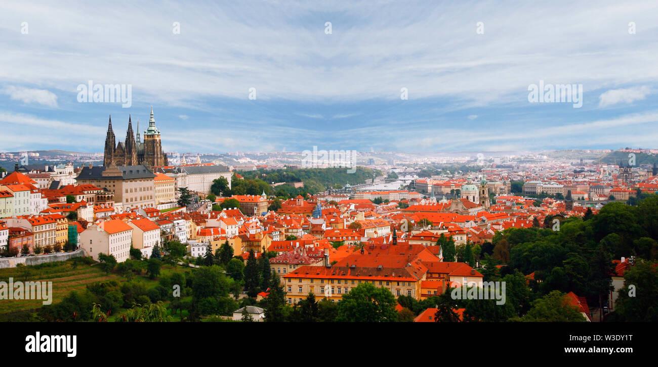 Prague Skyline, seen from Petrin Hill, dramatic blue cloudy sky. - Stock Image