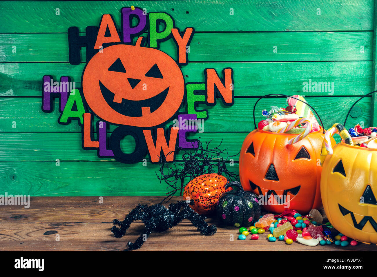 Happy Halloween Pumpkin With Candy In The Home Stock Photo Alamy