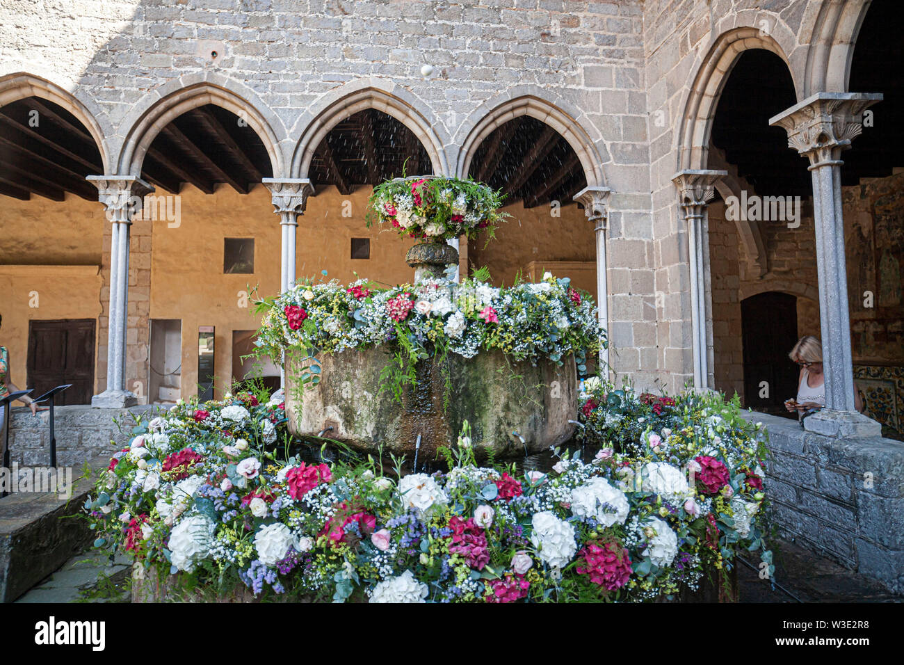 Barcelona, Spain. Cloister of Monastery of Pedralbes. Ou com balla in fountain, Corpus day tradition. - Stock Image