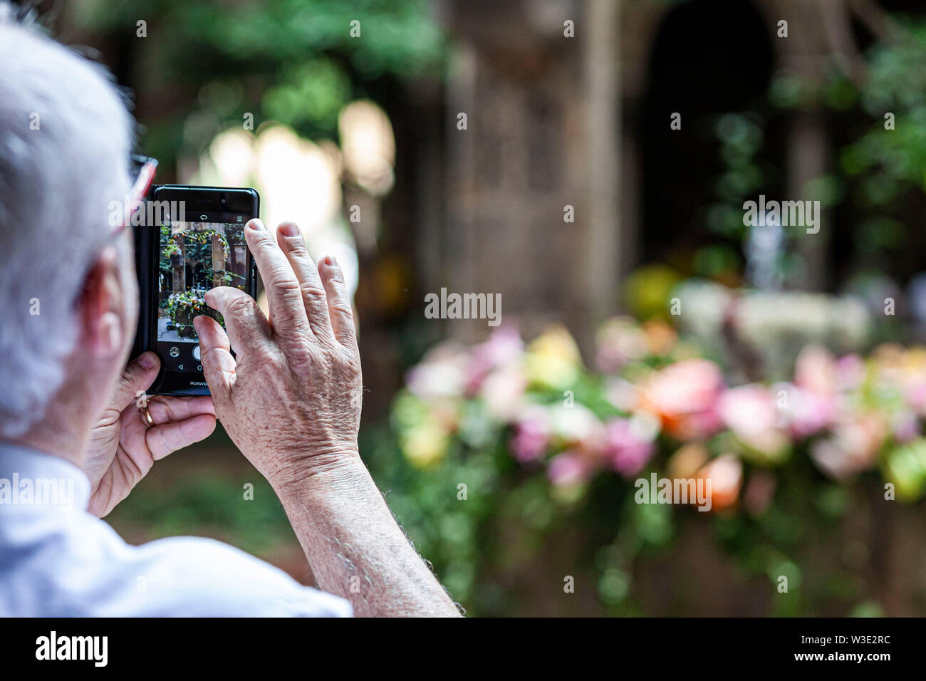 Barcelona, Spain.Cloister of church of Santa Anna. Ou com balla in fountain, Corpus day tradition. - Stock Image