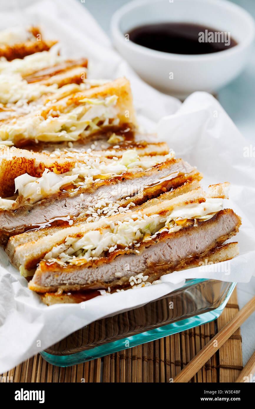 Katsu Sando - traditional japanese cutlet sandwich with deep fried  pork,cabbage,japanese mayonnaise and tonkatsu sauce on a light background  close-up Stock Photo - Alamy