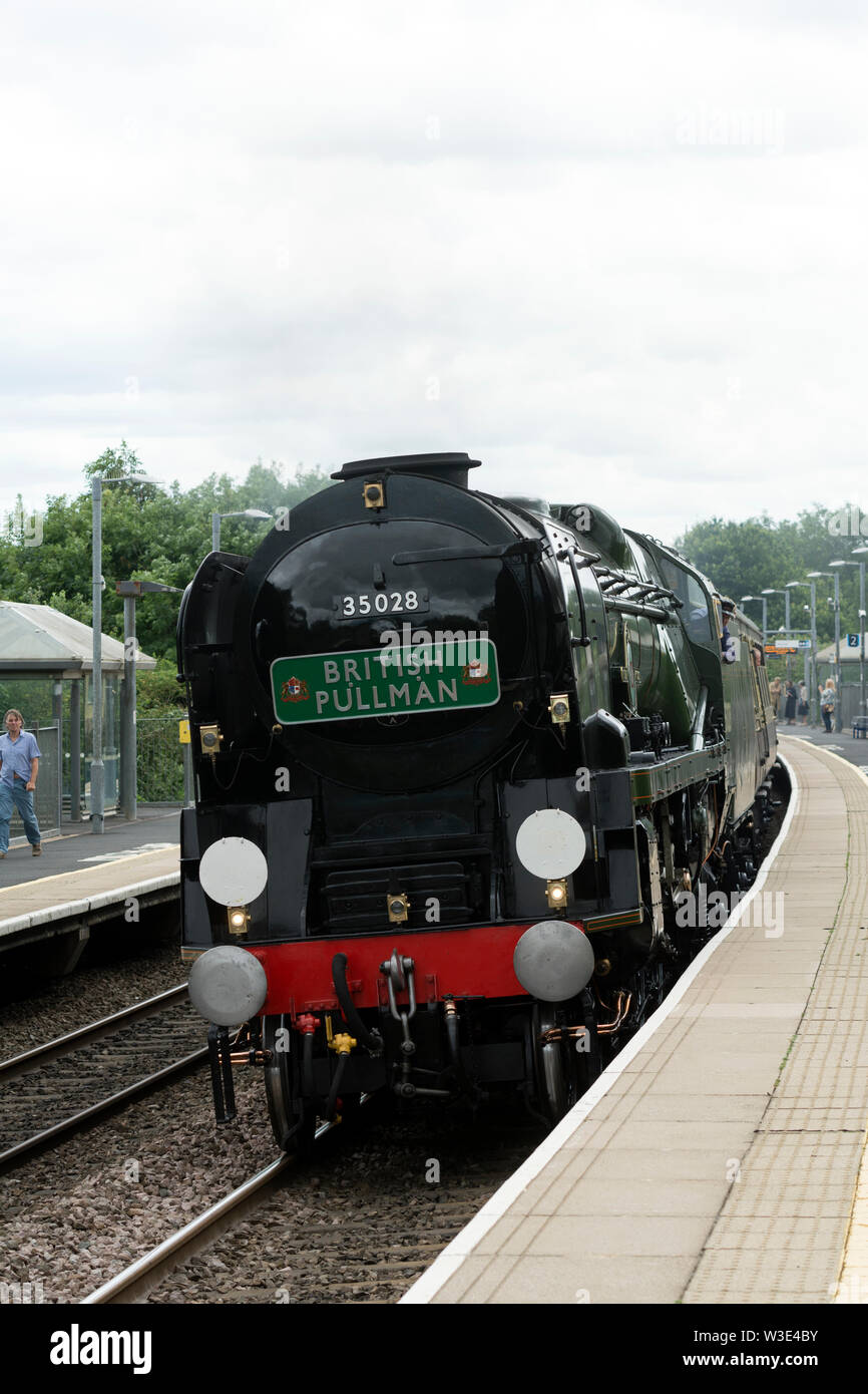 Southern Region Merchant Navy class steam locomotive 'Clan Line' arriving at Warwick Parkway station, Warwickshire, UK - Stock Image
