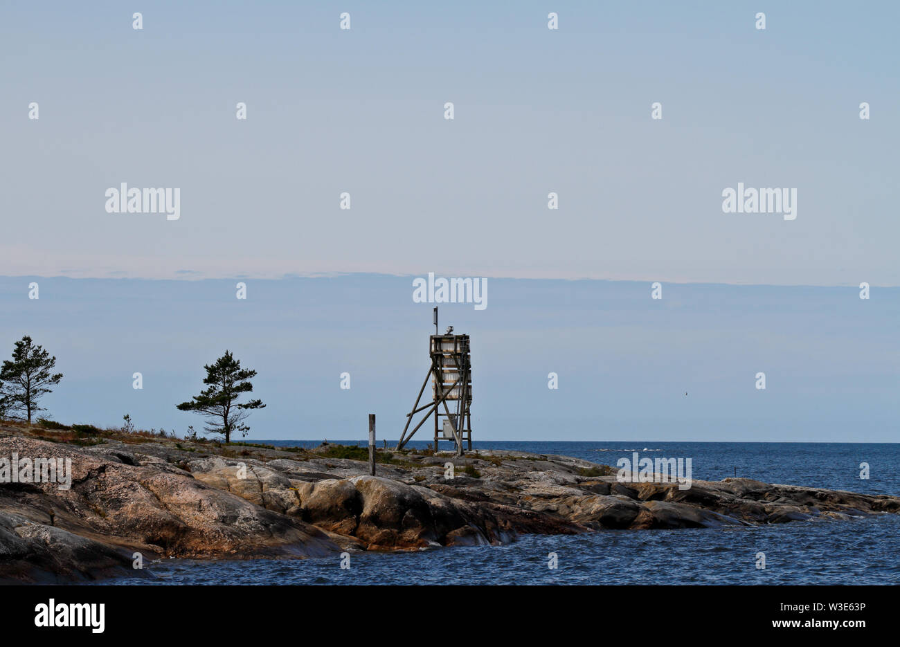 A  sea mark standing on a cliff on the islet of the Bothnian sea Stock Photo