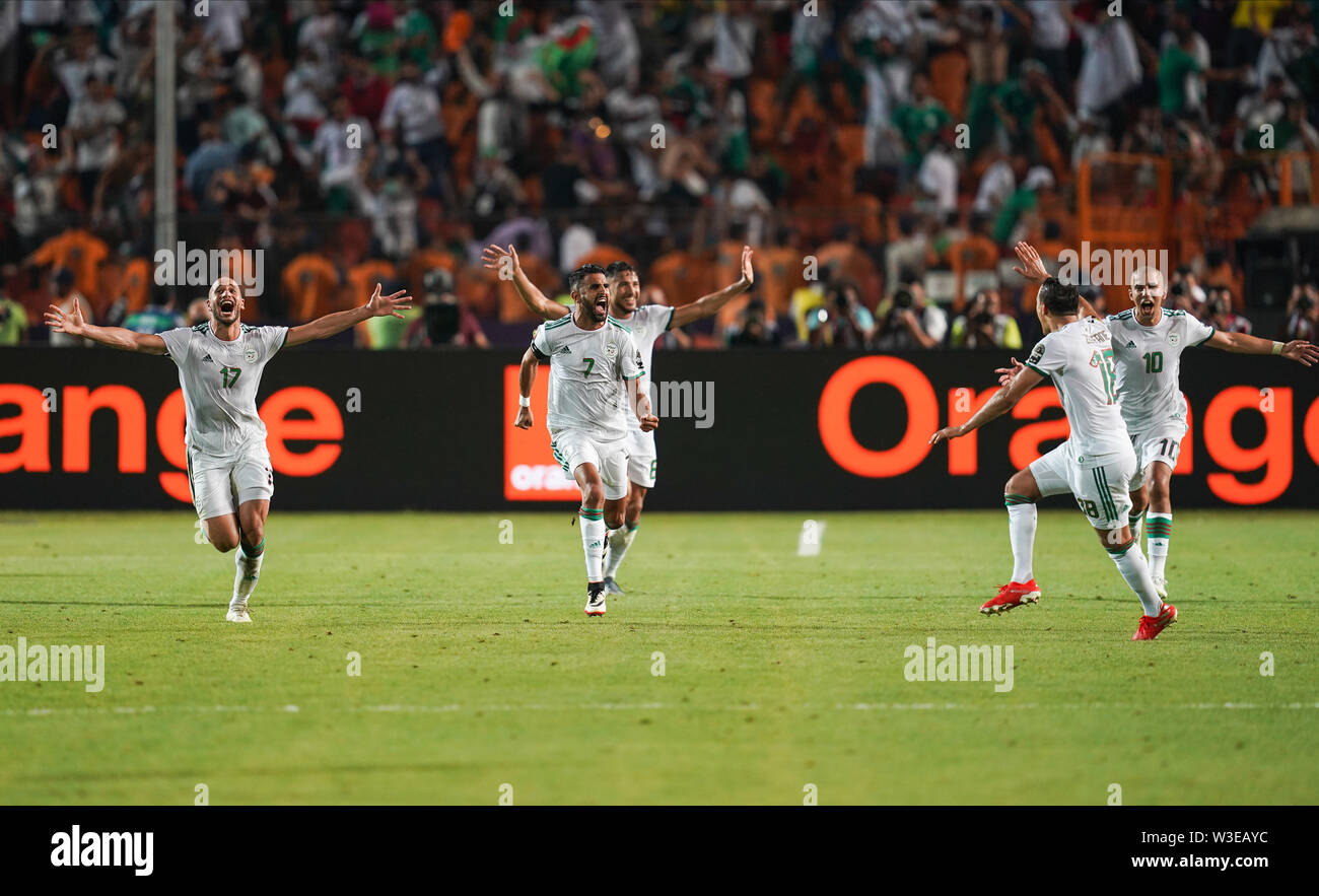 Cairo, Algeria, Egypt. 14th July, 2019. FRANCE OUT July 14, 2019: Riyad Karim Mahrez of Algeria celebrating the goal to 2-1 during the 2019 African Cup of Nations match between Algeria and Nigeria at the Cairo International Stadium in Cairo, Egypt. Ulrik Pedersen/CSM/Alamy Live News - Stock Image