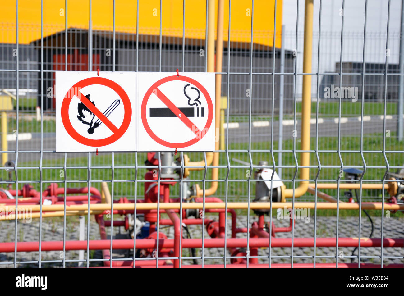 Sign Smoking is prohibited, fire is prohibited on the fence of an industrial facility. Flammable - Stock Image