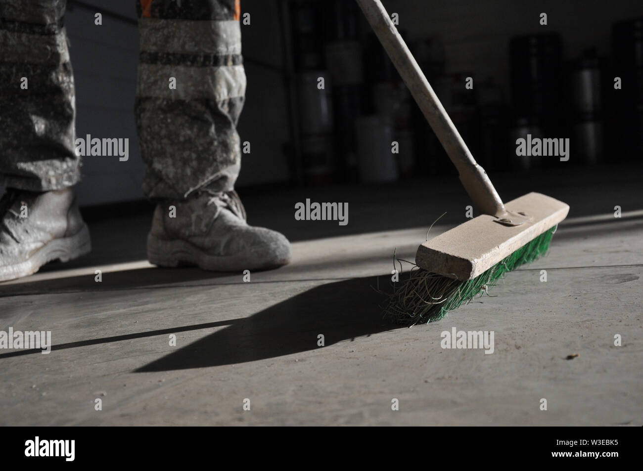 Cleaning of the production room using a brush. Manual cleaning. - Stock Image