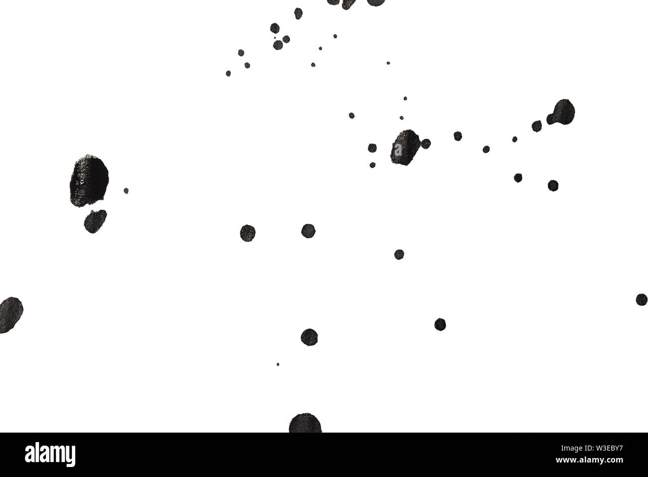 ink blot on the white background - Stock Image