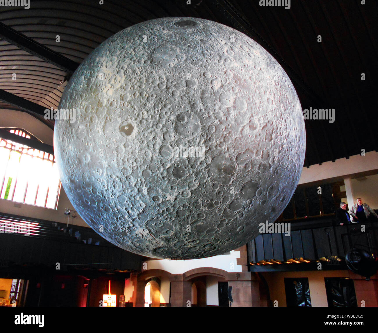 This massive art work is called, The Museum of the Moon, and is 7 metres in diameter and is made up from many, accurate images from NASA of the lunar surface, and is on a scale of 1:500,000. Each centimetre of the internally lit spherical sculpture represents 5km of the moons surface. The artist is Luke Jerram and this photo is from Glasgow where it was on display in 2018. ALAMY/ Alan Wylie © - Stock Image