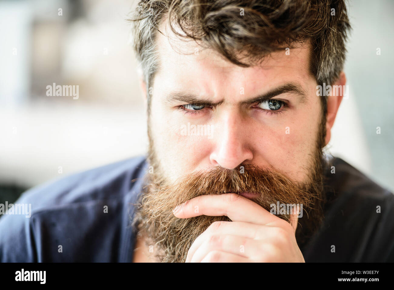 Making hard decision. Man with beard and mustache thoughtful troubled. Bearded man concentrated face. Hipster with beard thoughtful expression. Thoughtful mood concept. Making important life choices. - Stock Image