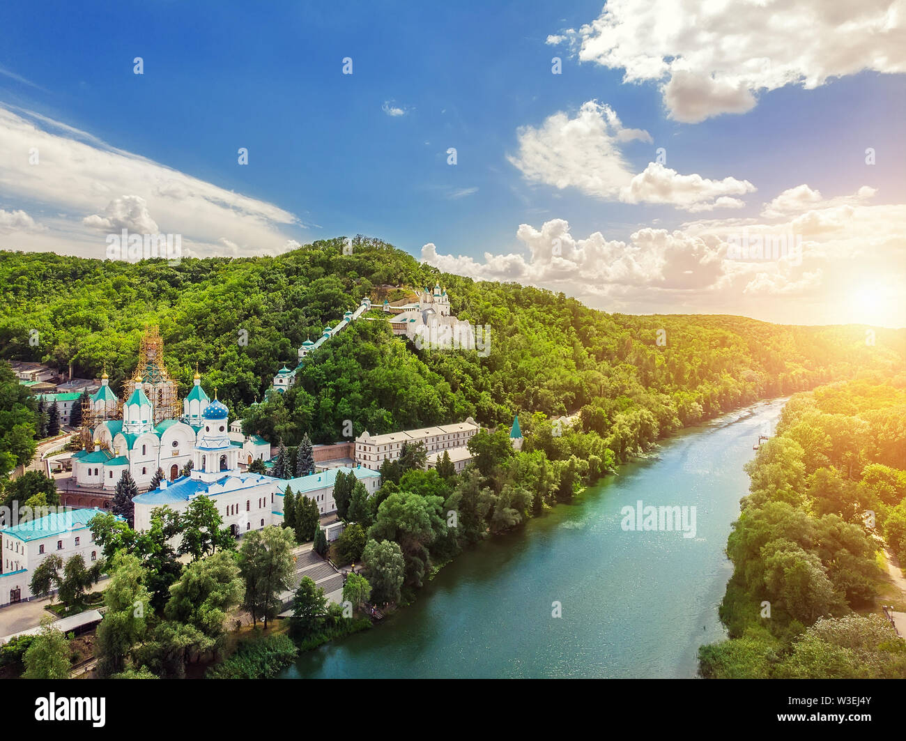 Svaytogorsk lavra ancient monastery hills panoramic view with green forest and Donets river at Donbass, Ukraine on bright sunny day. Ukraine travel de - Stock Image
