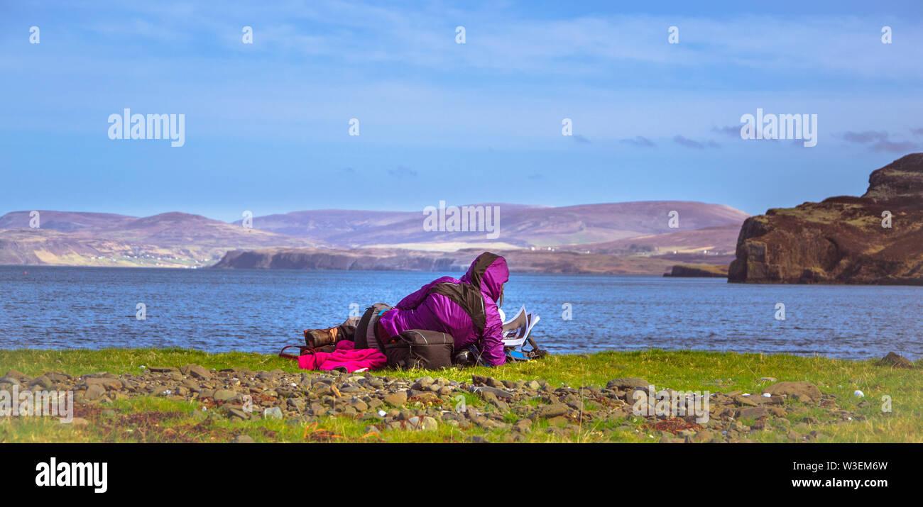 Young girl admiring ocean and mountains - Isle of Skye, Scotland - Stock Image