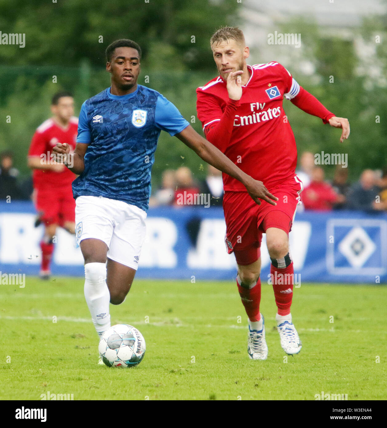 Kitzbuehel, Austria. 13th July, 2019. from left t Reec BROWN (Huddersfield), Aaron HUNT (Hamburg), .pre season friendly 2019/20, .Huddersfield Town FC vs Hamburger SV.Stadion Kitzbuehel/Austria, July 13, 2019, .Huddersfield Town, the relegated team of the Premiere League wins in a pre season friendly against the former German champion Hamburger SV. Credit: Wolfgang Fehrmann/ZUMA Wire/Alamy Live News - Stock Image