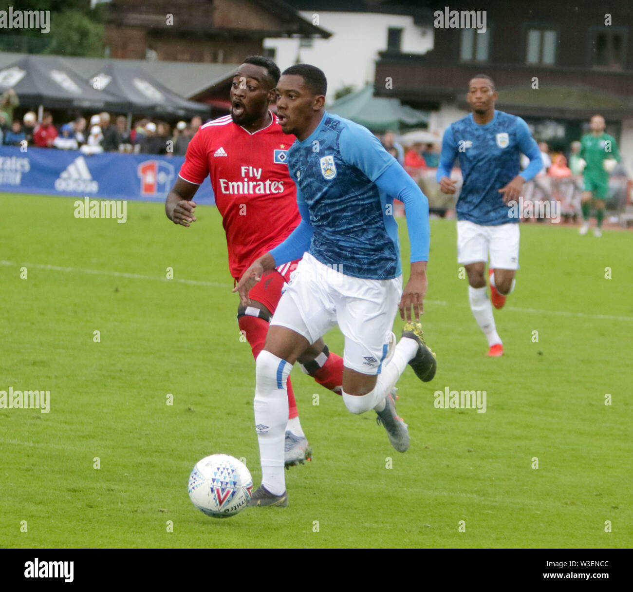 July 13, 2019 - Kitzbuehel, Austria - from left  Khaled NAREY (Hamburg), Jaden BROWN Huddersfield).pre season friendly 2019/20, .Huddersfield Town FC vs Hamburger SV,.Stadion Kitzbuehel/Austria, July 13, 2019, .Huddersfield Town, the relegated team of the Premiere League wins in a pre season friendly against the former German champion Hamburger SV. (Credit Image: © Wolfgang Fehrmann/ZUMA Wire) - Stock Image