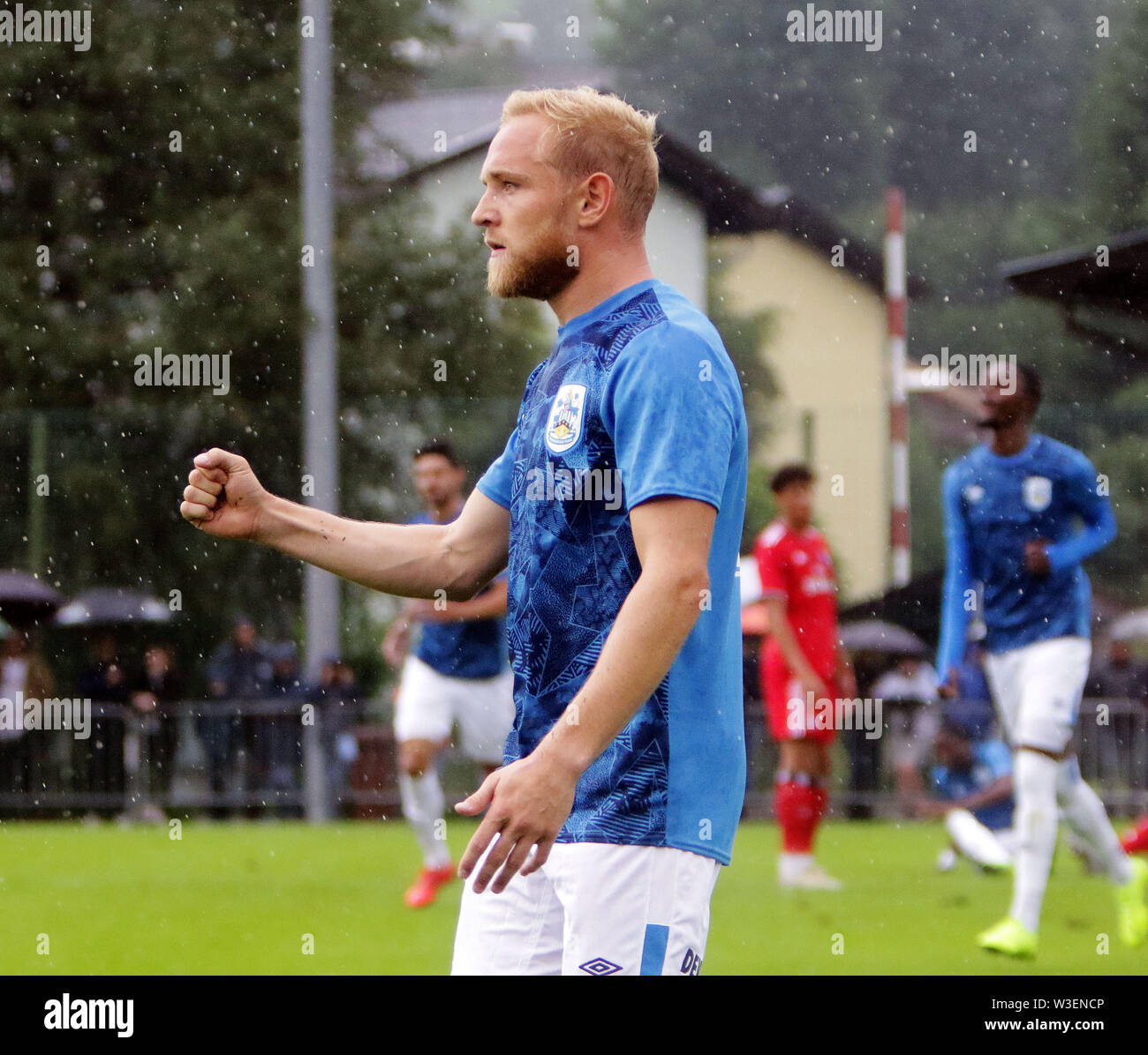 July 13, 2019 - Kitzbuehel, Austria - Alex PRICHART (Huddersfield),  celebrates the  goal in the rain,.pre season friendly 2019/20, .Huddersfield Town FC vs Hamburger SV,.Stadion Kitzbuehel/Austria, July 13, 2019, .Huddersfield Town, the relegated team of the Premiere League wins in a pre season friendly against the former German champion Hamburger SV. (Credit Image: © Wolfgang Fehrmann/ZUMA Wire) - Stock Image