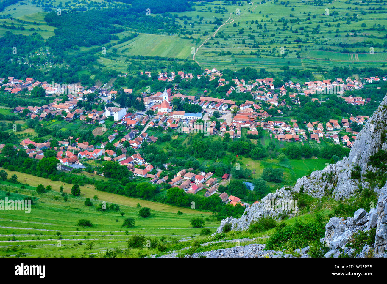 Rimetea village seen from a rock climbing route, part of Rimetea Climbing Open (RICO), in Trascau Mountains, Romania. Church and traditional Transylva - Stock Image