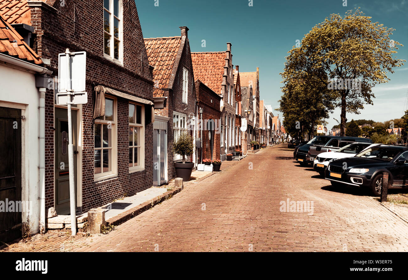 Beautiful little houses, town famous for its cheese production, stylish vintage city, nice European architecture, Edam, North Holland - Stock Image