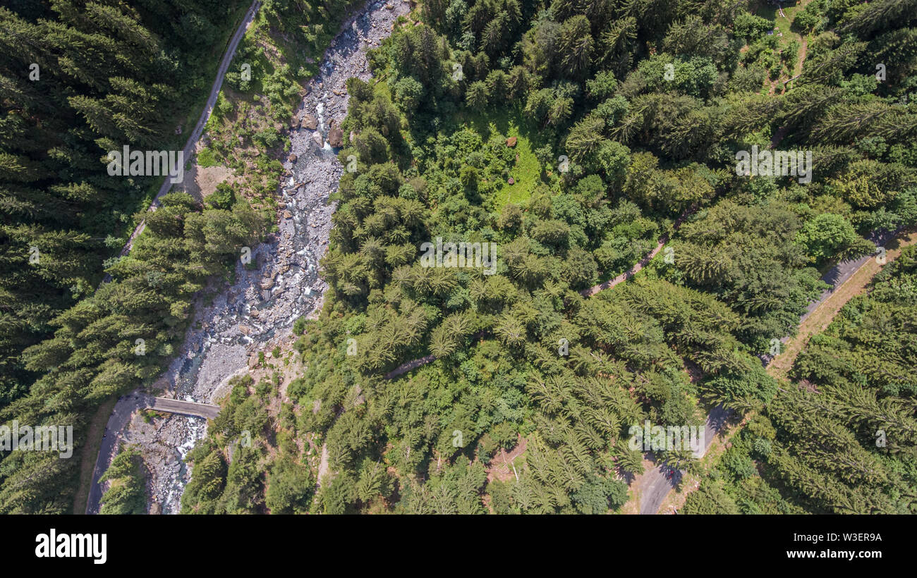 Over head drone view of a glacier melt alpine river valley. Stock Photo