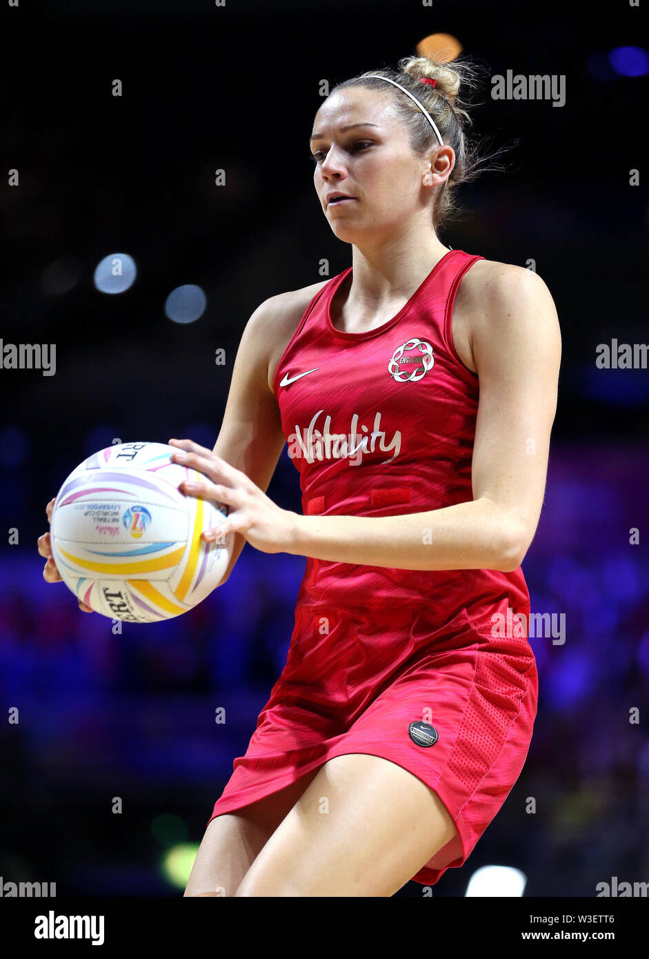 England's Joanne Harten warms up ahead of the match during the Netball World Cup match at the M&S Bank Arena, Liverpool. - Stock Image