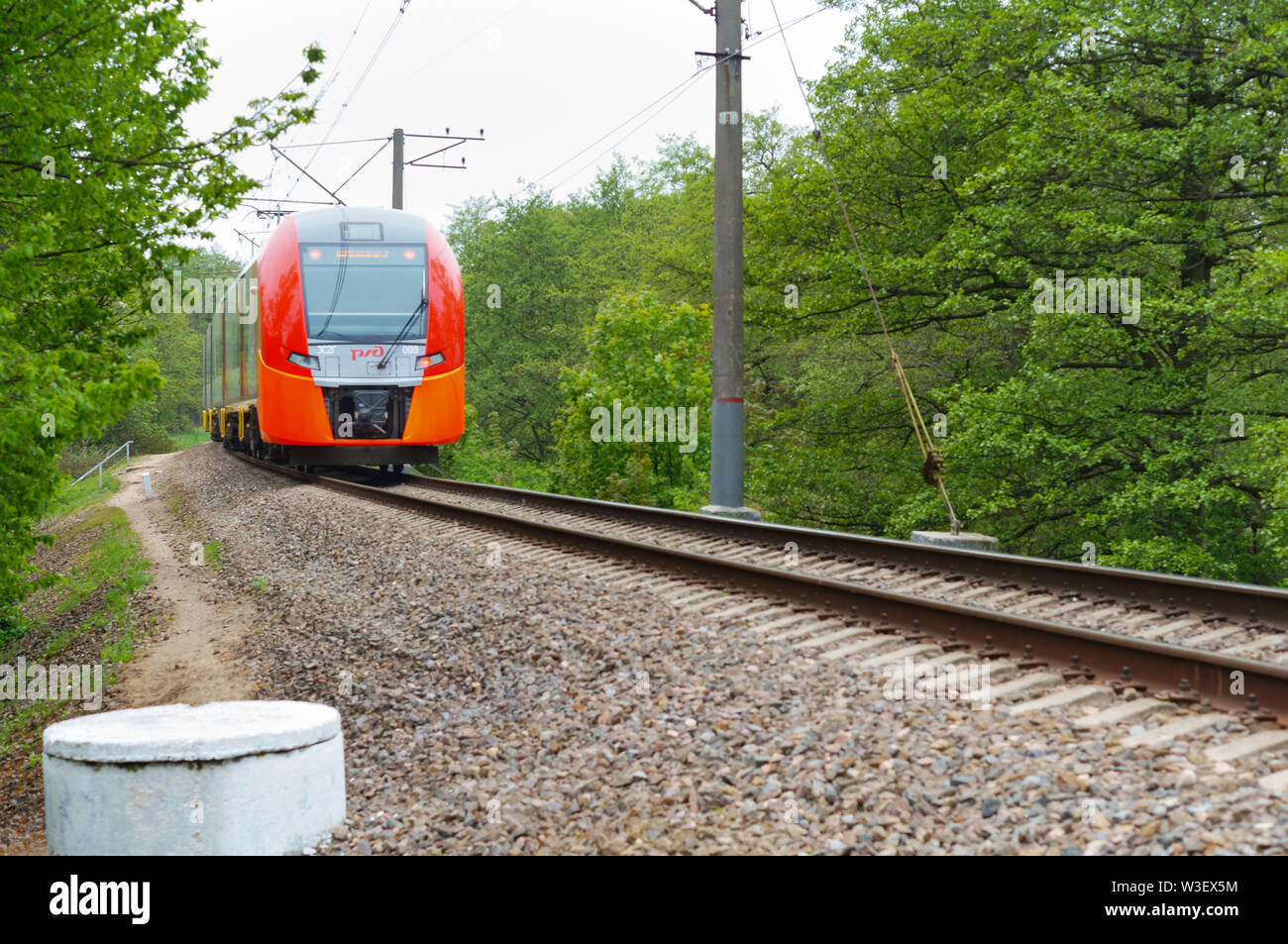 the train is in the distance, the train on the railway tracks, Russian Railways, Kaliningrad region, Russia, may 19, 2019 - Stock Image