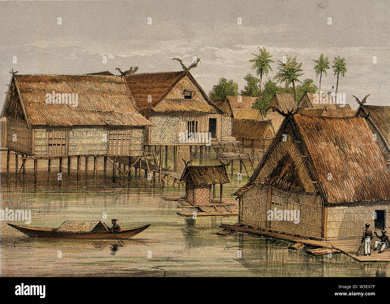 Borneo  a village raised on stilts above the water. Coloured lithograph by C.F. Kell after Carl Bock. - Stock Image