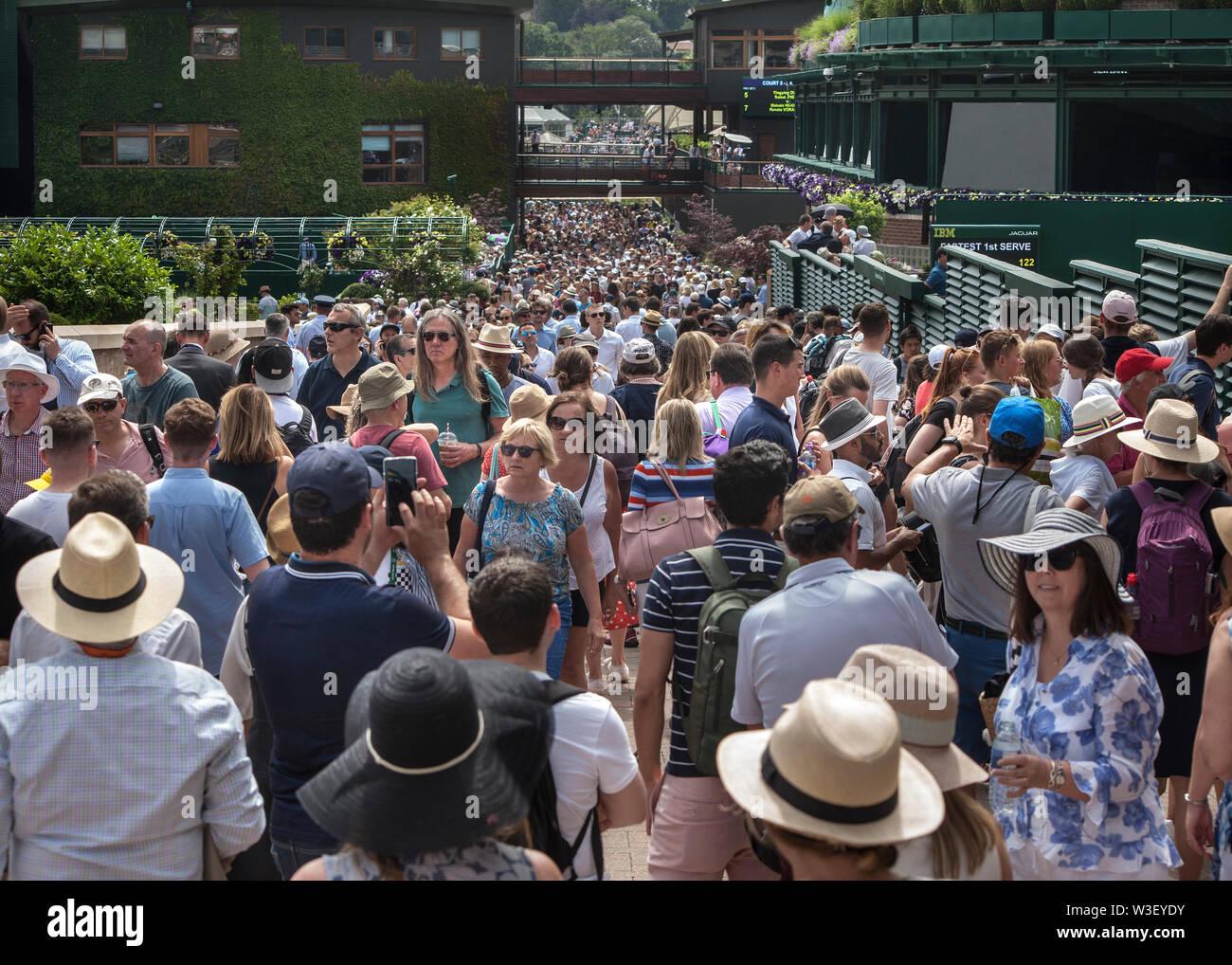 crowds of spectators at 2019 Wimbledon Stock Photo