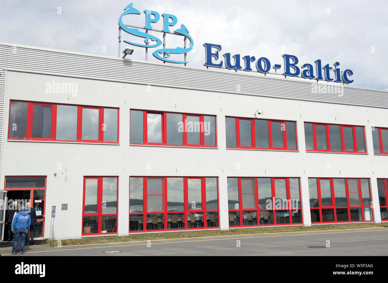 08 July 2019, Mecklenburg-Western Pomerania, Sassnitz: The factory building with the logo of the fish factory EuroBaltic of the Dutch Parlevliet & Van der Plas Group (P&P) in Sassnitz-Mukran. The EuroBaltic fishing plant on the island of Rügen is one of the largest fish processors in Europe, processing up to 50,000 tonnes of herring from the North and Baltic Seas. Photo: Stefan Sauer/dpa-Zentralbild/ZB - Stock Image