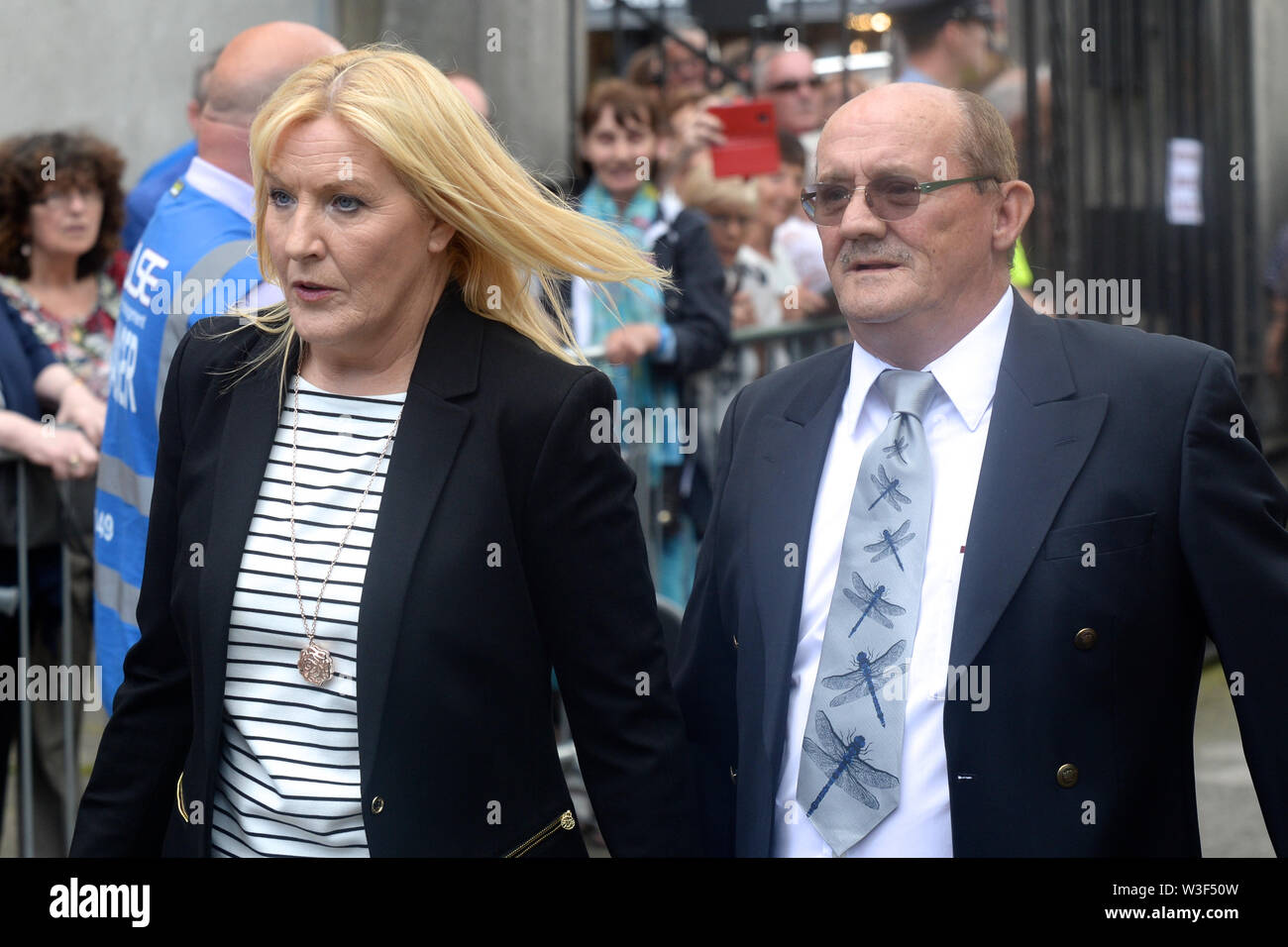 Brendan O'Carroll and his Wife Jennifer arrive for the funeral of Father Ted star Brendan Grace at the Church of St. Nicholas of Myra, Dublin. - Stock Image