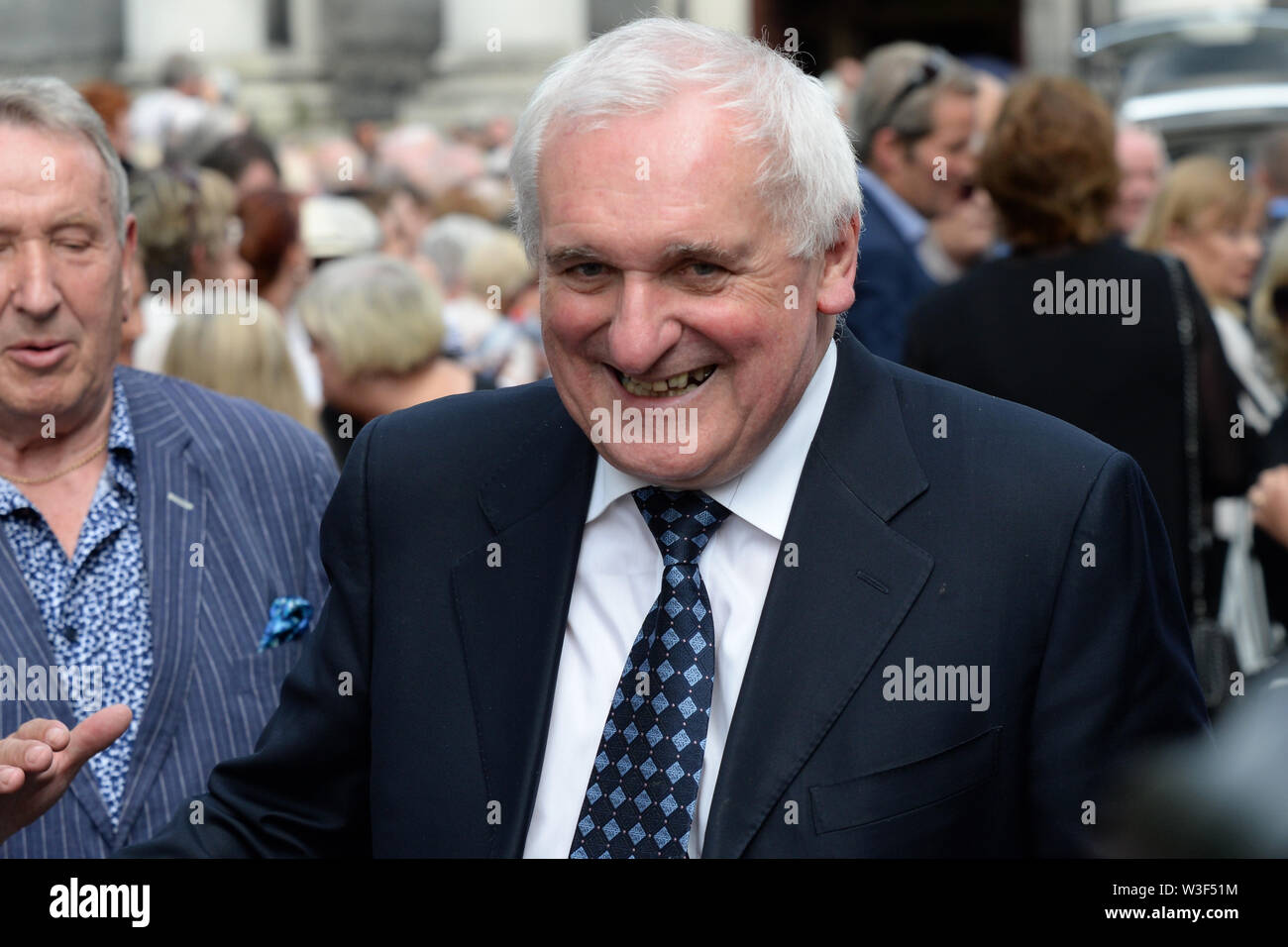 Former Taoiseach Bertie Ahern arrives for the funeral of Father Ted star Brendan Grace at the Church of St. Nicholas of Myra, Dublin. - Stock Image