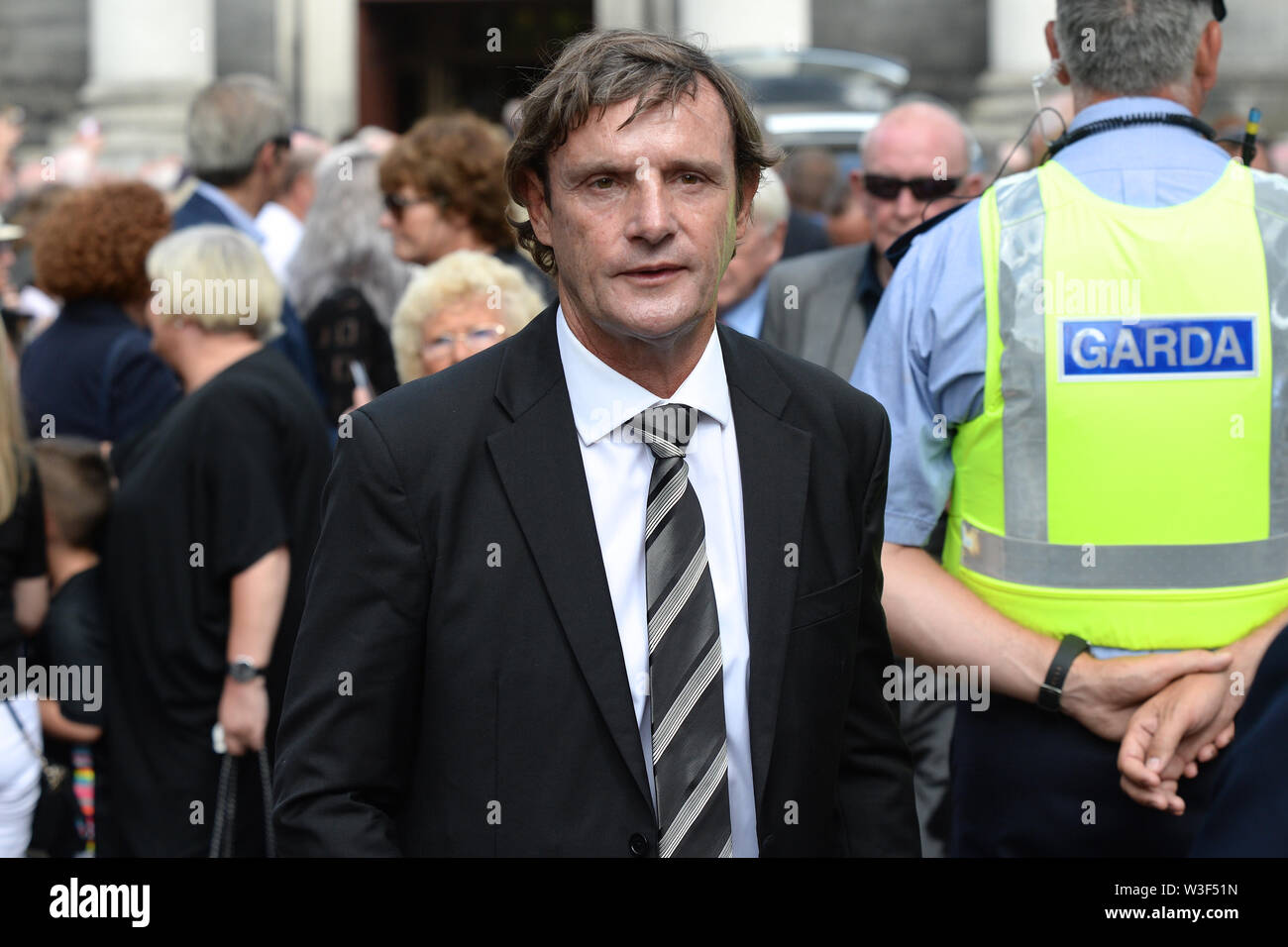 Former Manchester Utd and Ireland defender Kevin Moran arrives for the funeral of Father Ted star Brendan Grace at the Church of St. Nicholas of Myra, Dublin. - Stock Image