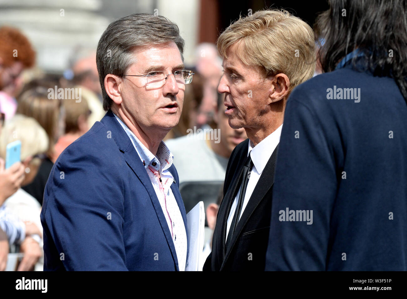 Daniel O'Donnell and Dickie Rock arrive for the funeral of Father Ted star Brendan Grace at the Church of St. Nicholas of Myra, Dublin. - Stock Image
