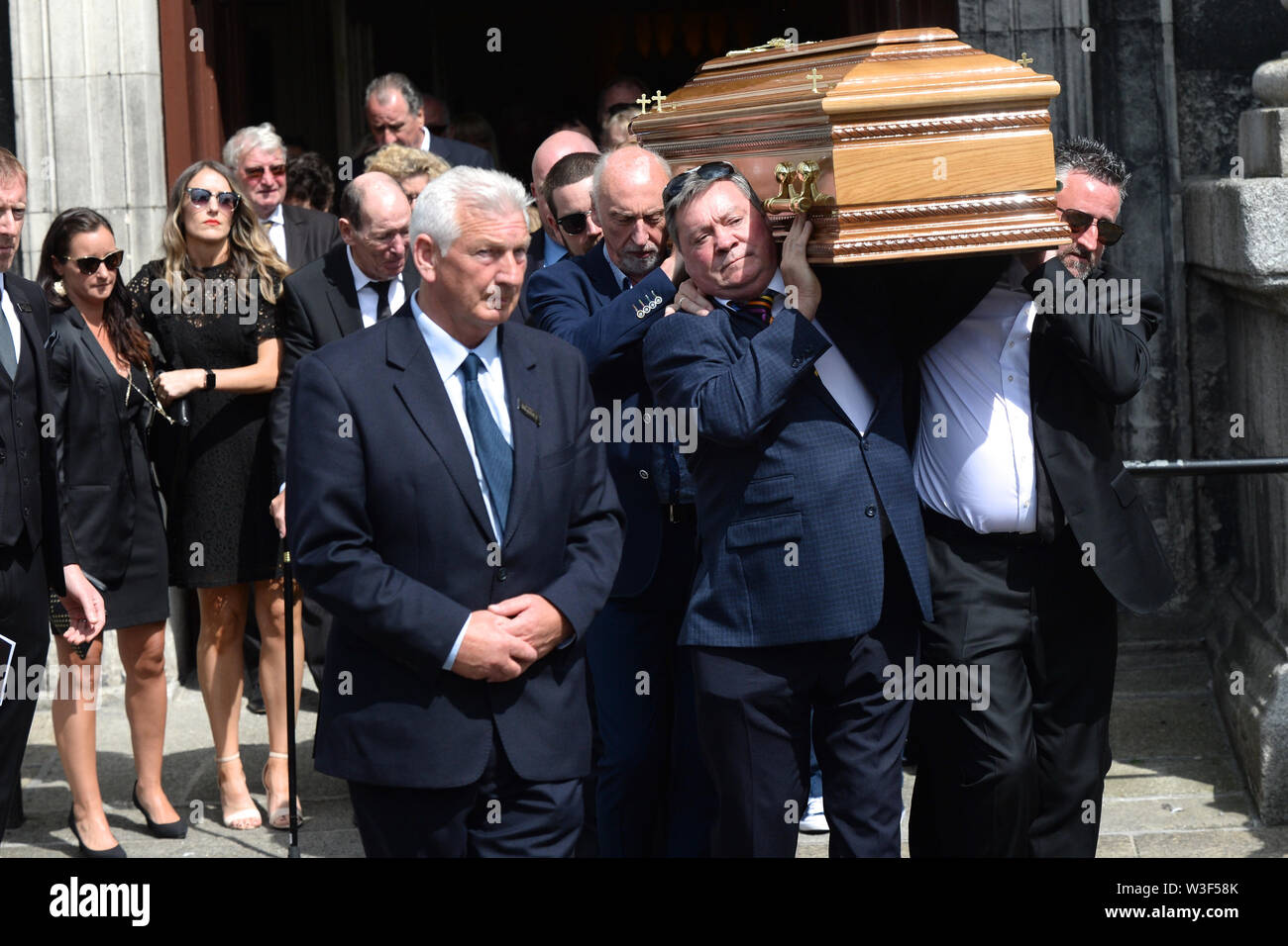 The coffin of Father Ted star Brendan Grace is carried out of the Church of St. Nicholas of Myra, Dublin. - Stock Image