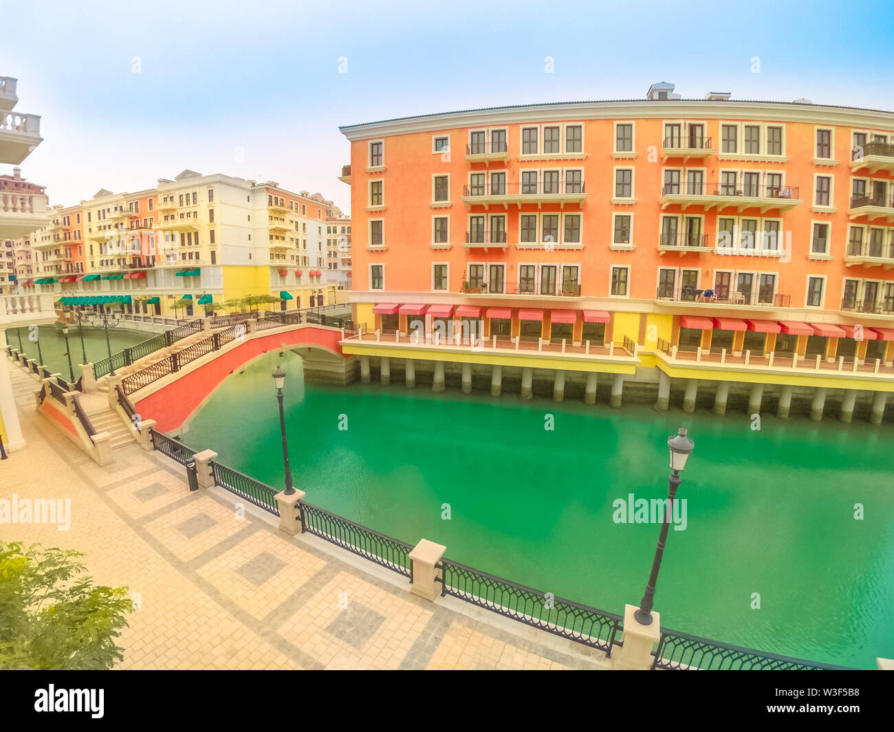 Wide angle view of panoramic bridge in Venice at Qanat Quartier in the Pearl, Persian Gulf, Middle East. Aerial picturesque district icon of Doha, Qat - Stock Image