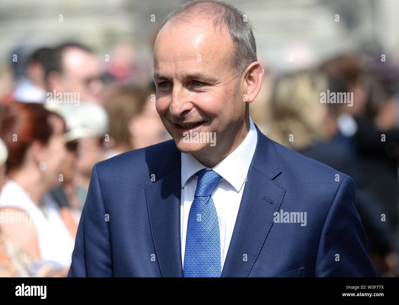 Fianna Fail leader Michael Martin arrives for the funeral of Father Ted star Brendan Grace at the Church of St. Nicholas of Myra, Dublin. - Stock Image