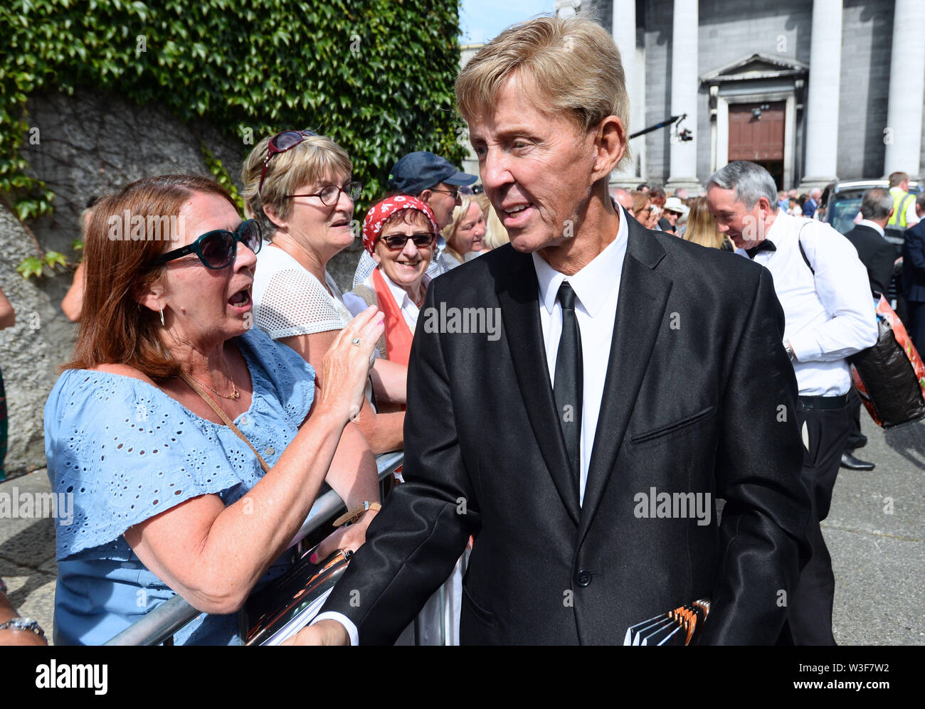 Singer Dickie Rock arrives for the funeral of Father Ted star Brendan Grace at the Church of St. Nicholas of Myra, Dublin. - Stock Image