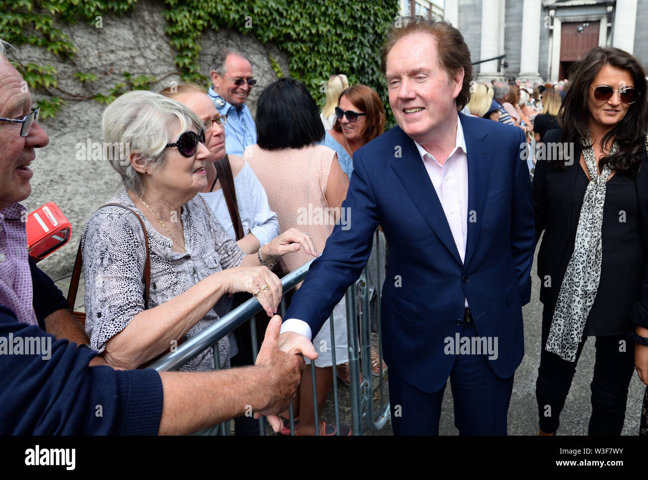 Entertainer and friend Red Hurley arrives for the funeral of Father Ted star Brendan Grace at the Church of St. Nicholas of Myra, Dublin. - Stock Image