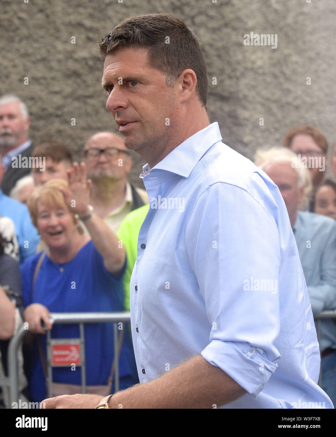 Former footballer and businessman Niall Quinn arrives for the funeral of Father Ted star Brendan Grace at the Church of St. Nicholas of Myra, Dublin. - Stock Image