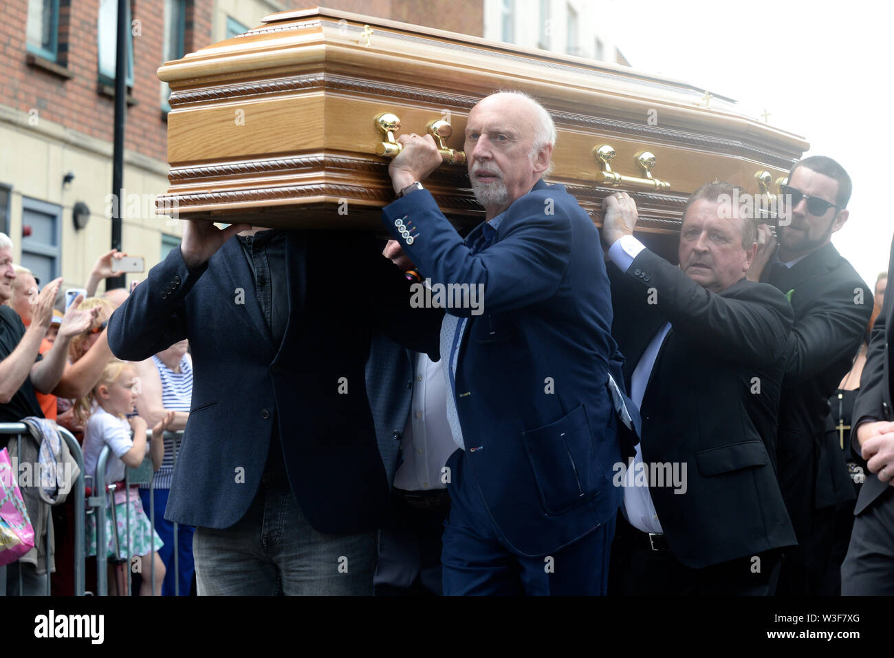 The coffin of Father Ted star Brendan Grace is carried into the Church of St. Nicholas of Myra, Dublin. - Stock Image