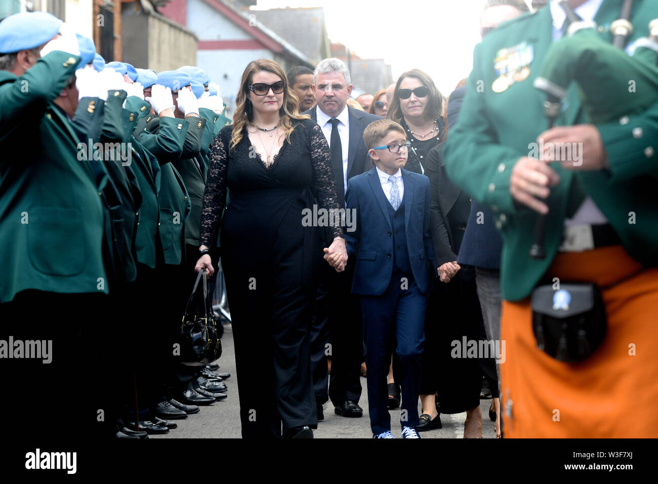 Family members at the funeral of Father Ted star Brendan Grace at the Church of St. Nicholas of Myra, Dublin. - Stock Image