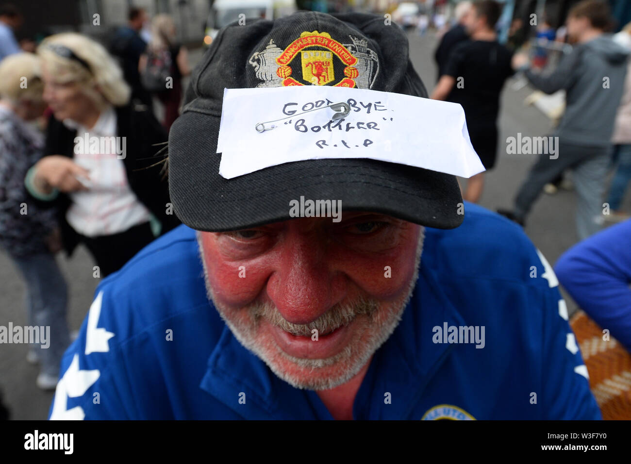 A mourner at the funeral of Father Ted star Brendan Grace outside the Church of St. Nicholas of Myra, Dublin. - Stock Image