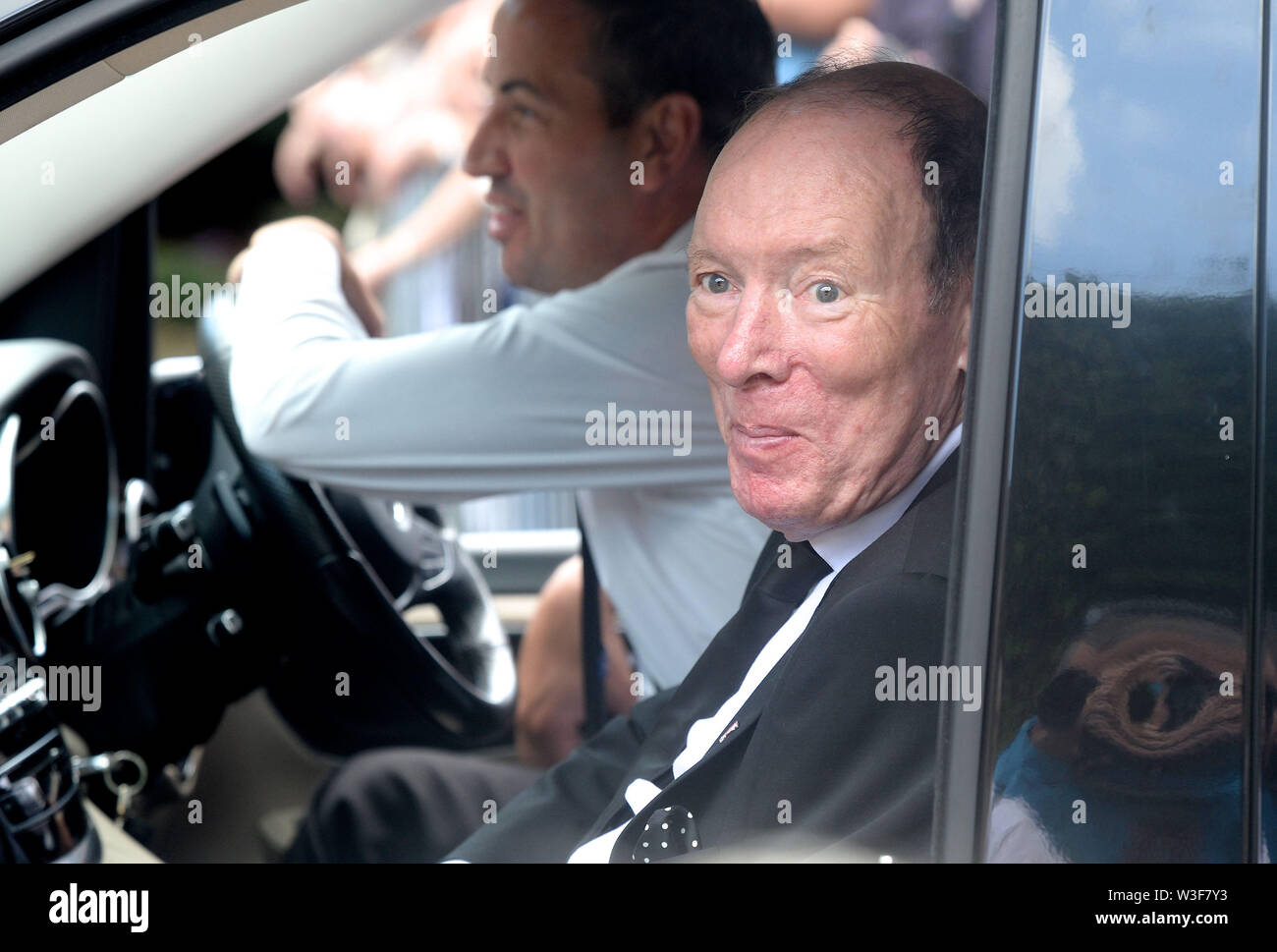 Hotelier and friend Tom Moran arrives for the funeral of Father Ted star Brendan Grace at the Church of St. Nicholas of Myra, Dublin. - Stock Image