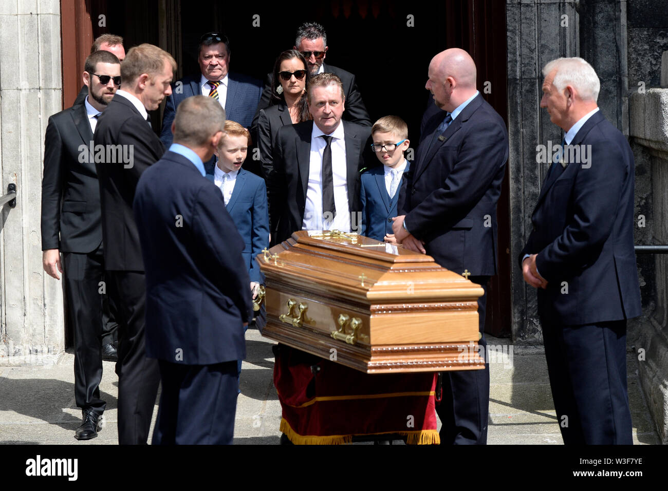 The coffin of Father Ted star Brendan Grace outside the Church of St. Nicholas of Myra, Dublin, following his funeral. - Stock Image