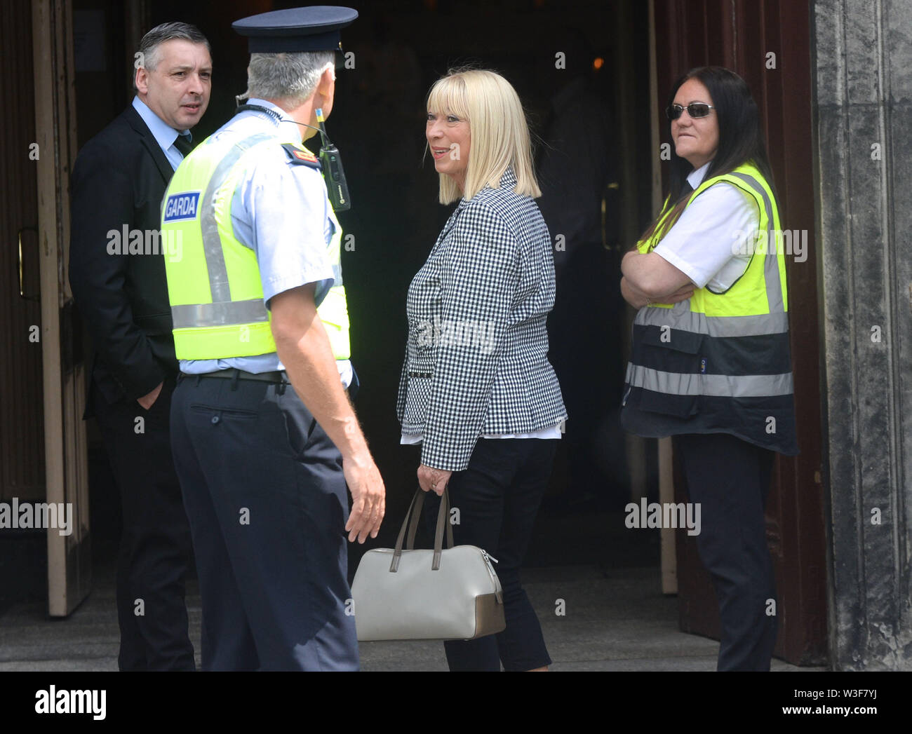 Ann Doyle arrives for the funeral of Father Ted star Brendan Grace at the Church of St. Nicholas of Myra, Dublin. - Stock Image
