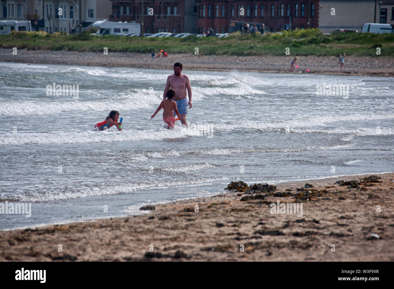 Paddling in the Irish sea from Skerries beach, Co. Dublin - Stock Image