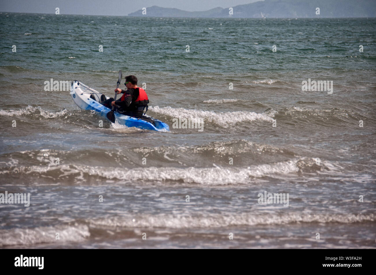 Cannoning in the Irish Sea at Skerries in Co. Dublin, Ireland - Stock Image