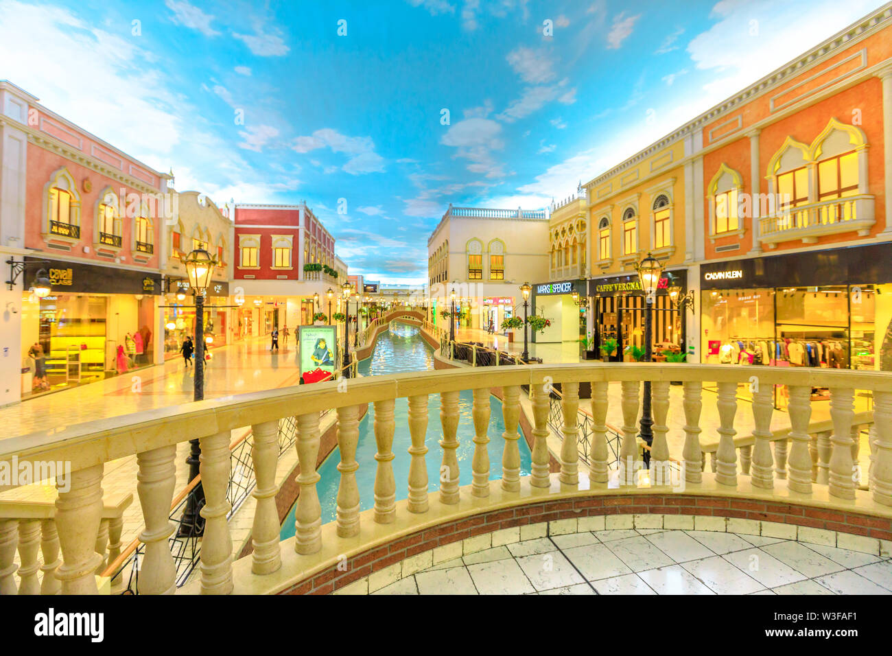Doha, Qatar - February 21, 2019: balcony at venice canal in Villaggio Mall, a shopping center in Aspire Zone. Luxury brands, expensive stores and excl - Stock Image